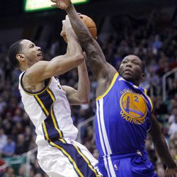 Utah Jazz guard Devin Harris (5) drives hard to the hoop for a basket with Golden State's #2 Nate Robinson defending as the Utah Jazz and the Golden State Warriors play Friday, April 6, 2012 in Salt Lake City. Jazz won 104-98.