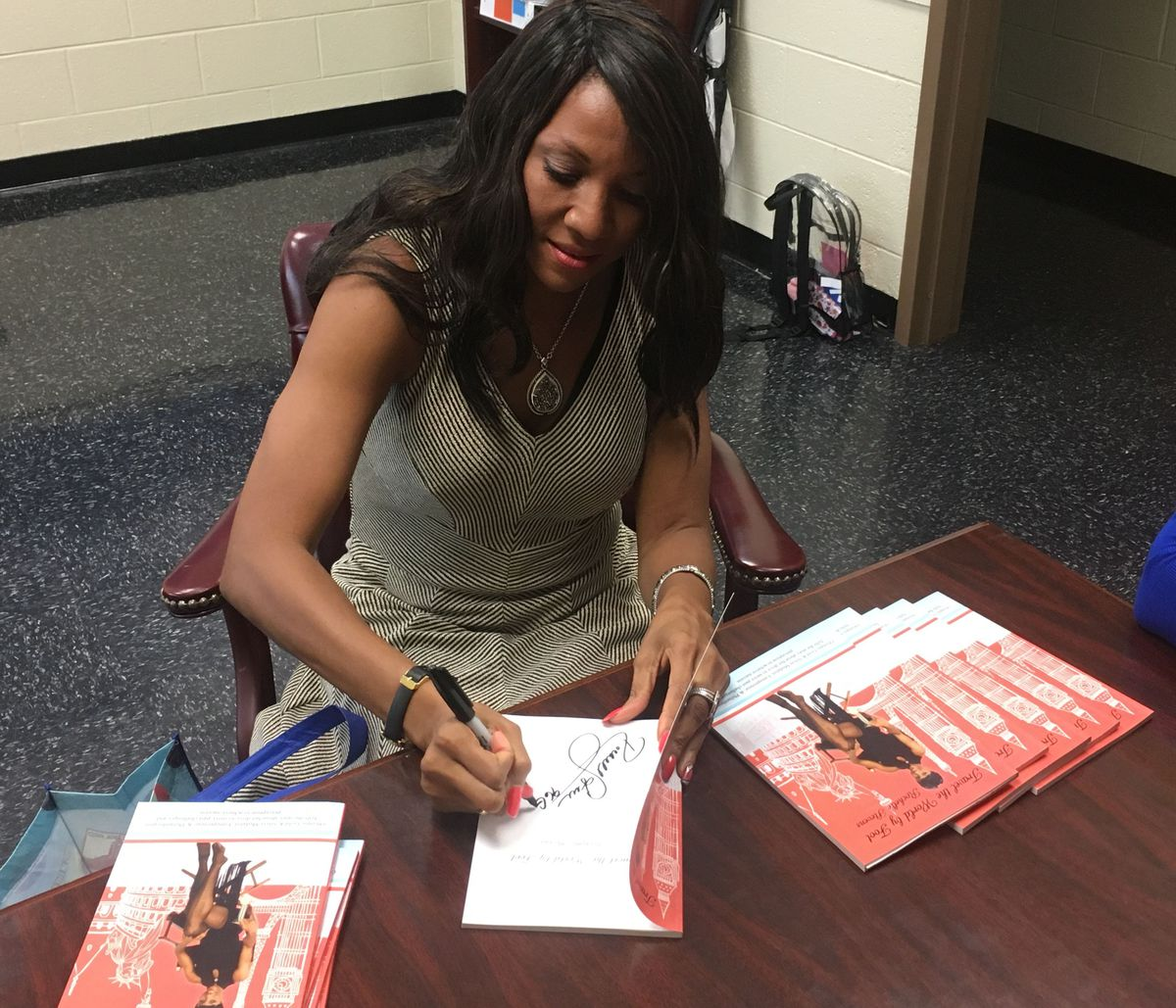 Stevens signs copies of her new autobiography for students to win for good behavior.