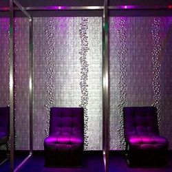 Purple chairs and alien walls in the back room for lap dances.