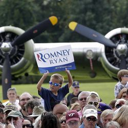 A boy waits for Republican presidential candidate Mitt Romney campaigns at the Military Aviation Museum in Virginia Beach, Va., Saturday, Sept. 8, 2012.