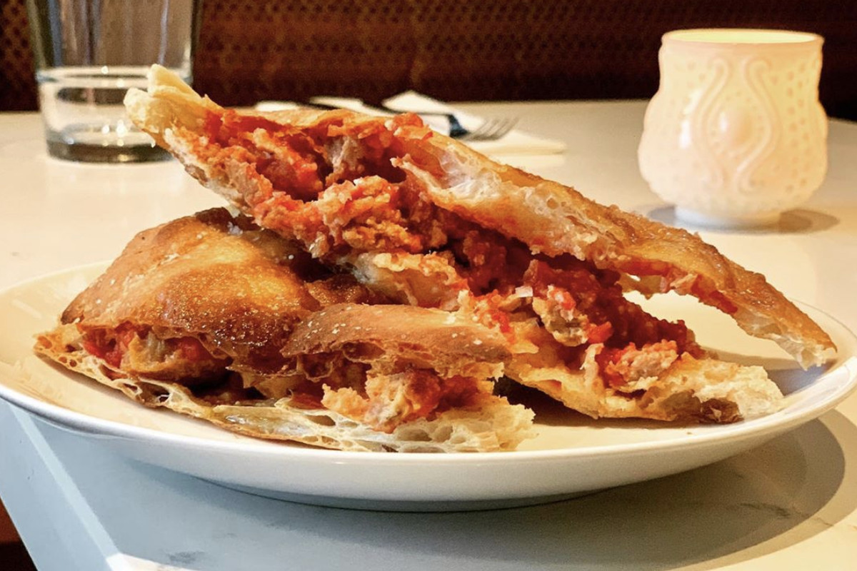A meatball sandwich at Bar Taglio on a white plate.