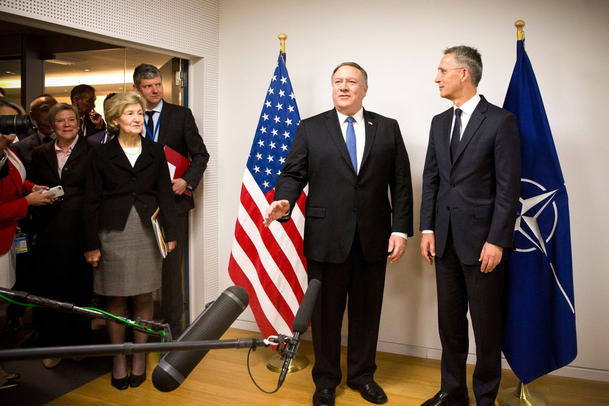 US Secretary of State Mike Pompeo (center, left) and NATO Secretary General Jens Stoltenberg (center, right), speak to media prior to a meeting at NATO headquarters in Brussels on April 27, 2018.