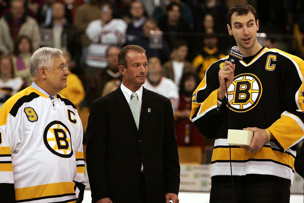 Stuck in the middle... Charlie Jacobs, flanked by Johnny Bucyk and Zdeno Chara