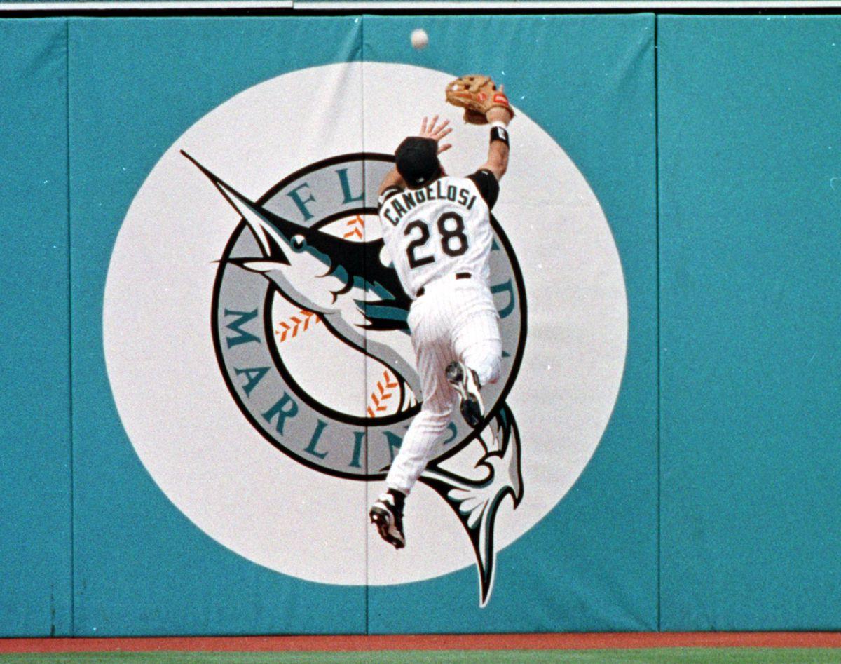 Florida Marlins' outfielder John Cangelosi tries t