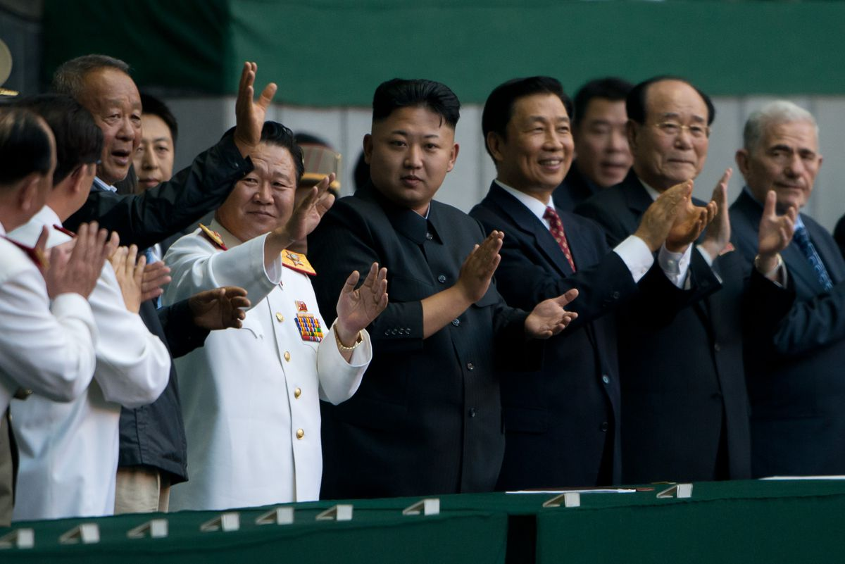Kim Jong Un with other senior North Korean officials (Ed Jones/AFP/Getty)