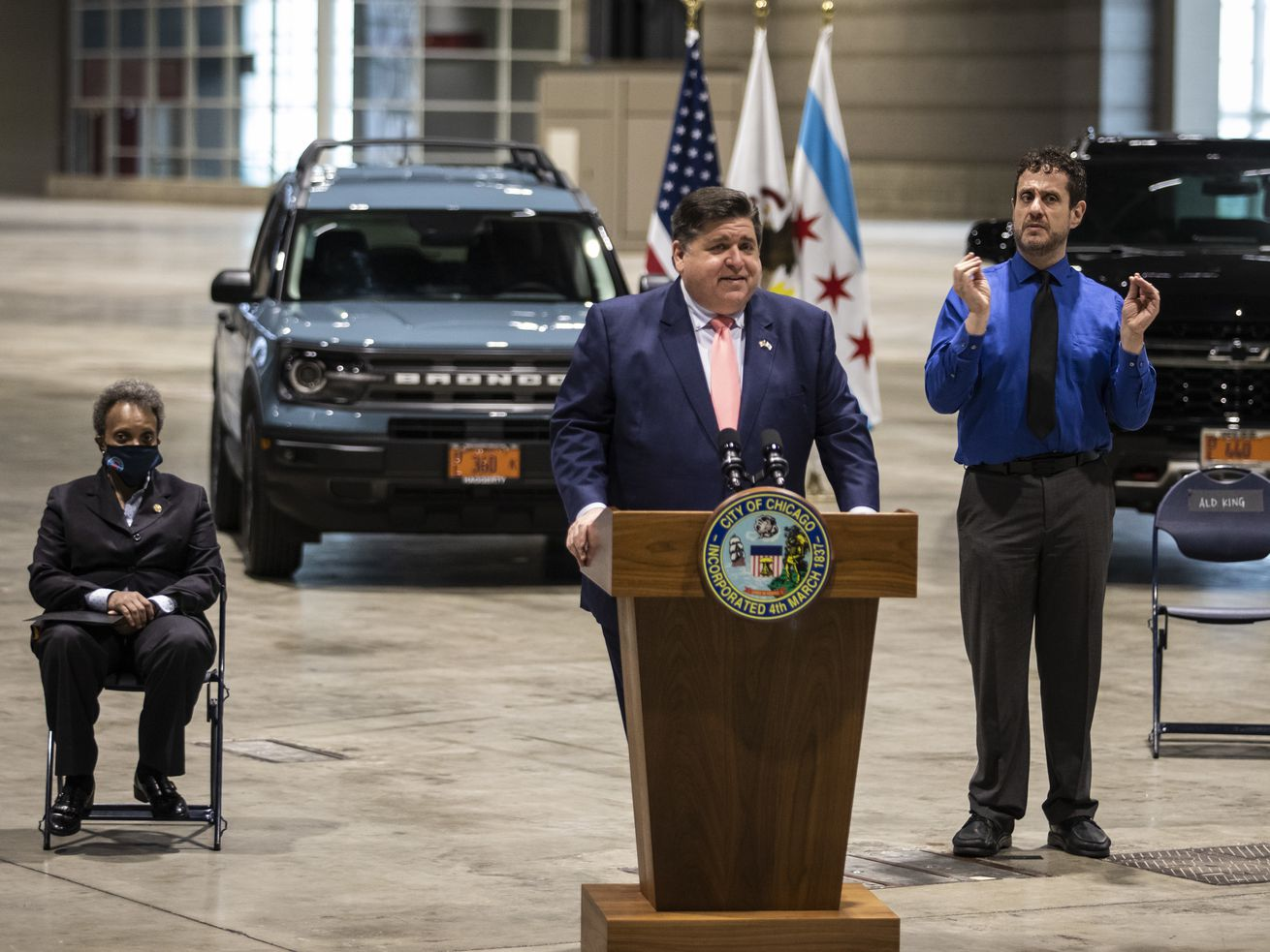 Gov. J.B. Pritzker speaks during a news conference at McCormick Place, Tuesday morning as Mayor Lori Lightfoot listens.