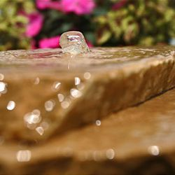 A small fountain found in a aqua-pot kit is one of the various do-it-yourself water features homeowners can complete in short time.