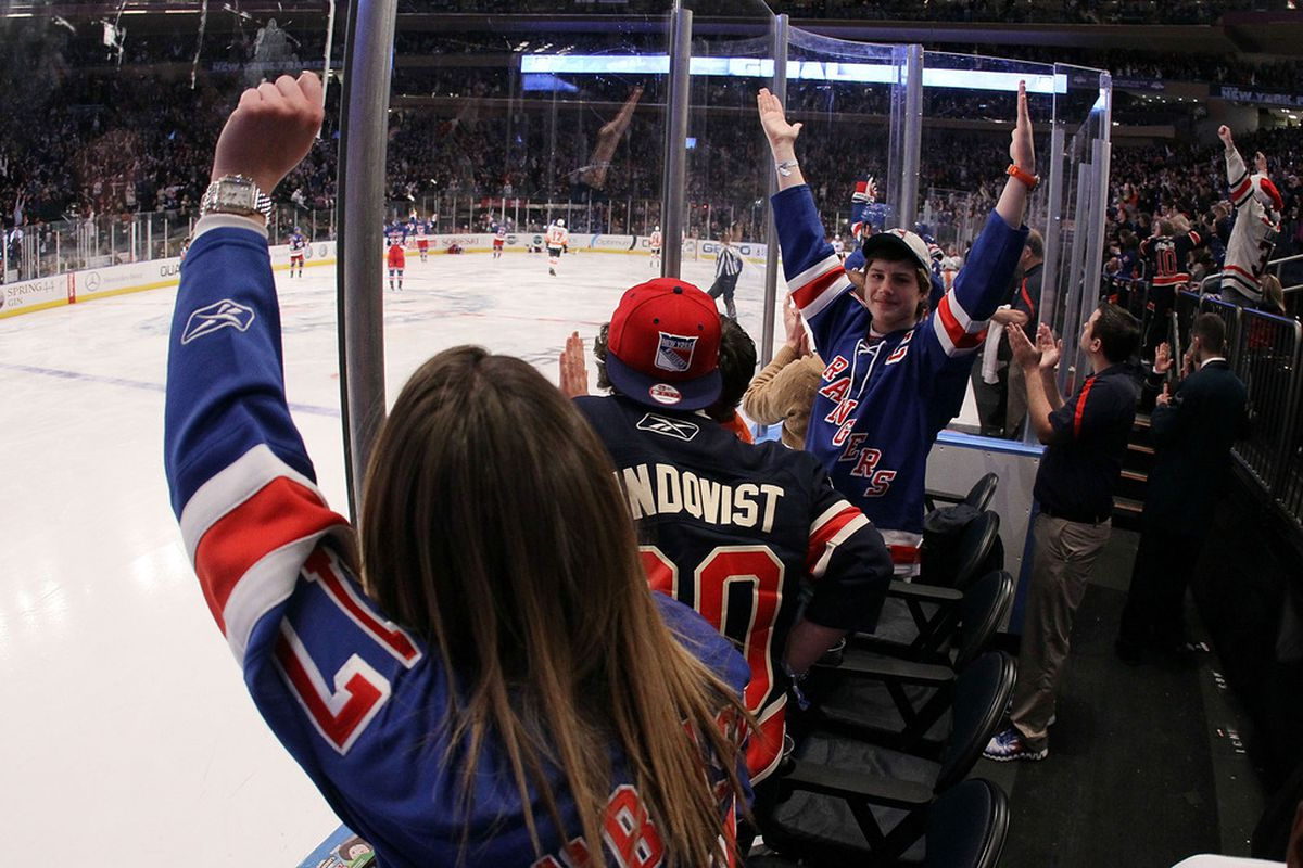 NEW YORK, NY - DECEMBER 23:  New York Ranger fans celebrate their teams third goal of the game against the Philadelphia Flyers on December 23, 2011 at Madison Square Garden in New York City.  (Photo by Jim McIsaac/Getty Images)
