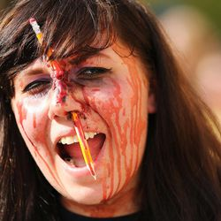 Angelina Ericksen participates in the Zombie Walk in Salt Lake City Sunday, Aug. 30, 2015. The eighth annual Zombie Walk was held to raise awareness and donations for the Utah Food Bank.