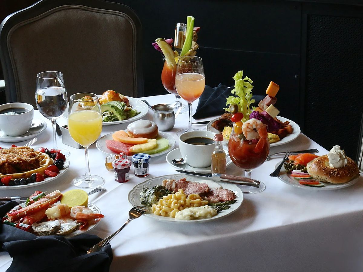 Brunch dishes and beverages spread out on a table.