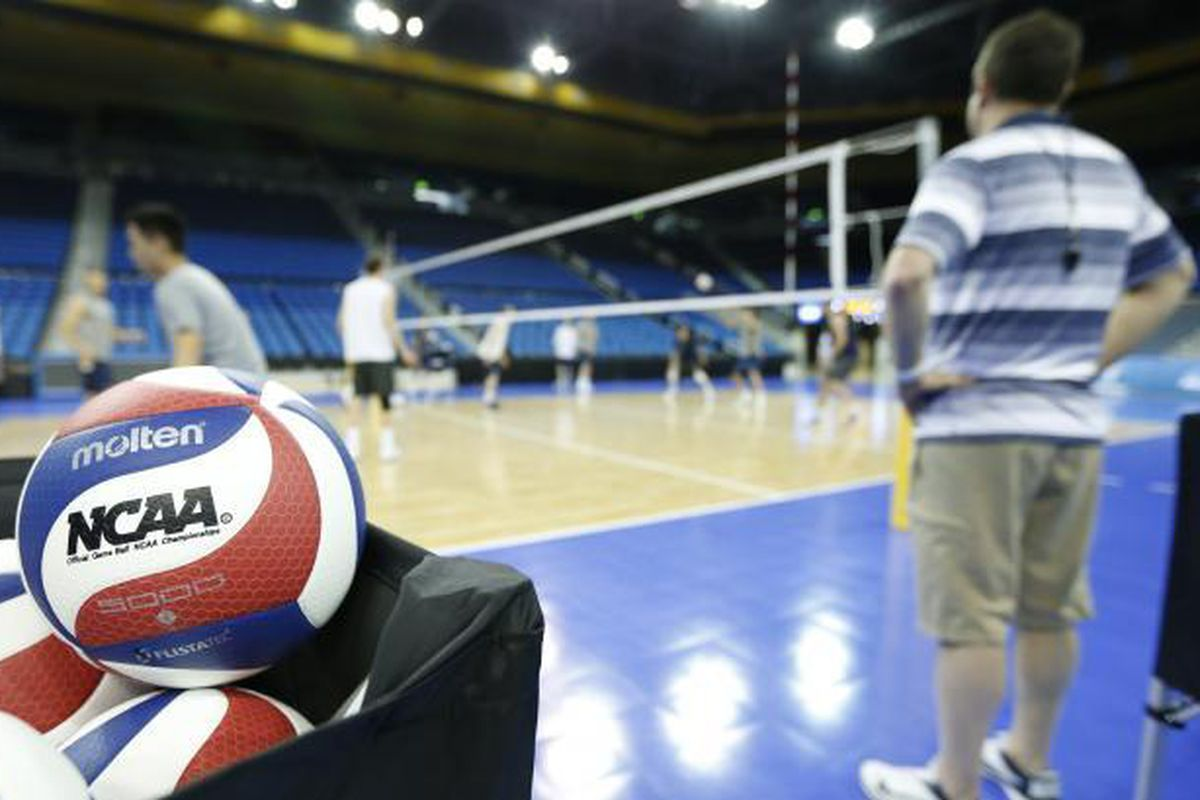BYU Men's volleyball warms up.