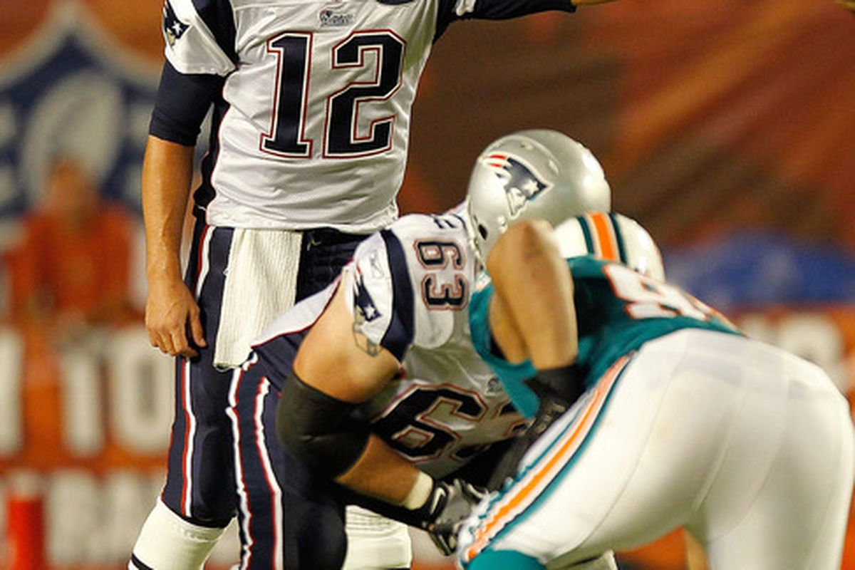 MIAMI GARDENS, FL - SEPTEMBER 12:   Tom Brady #12 of the New England Patriots calls a play during a game against the Miami Dolphins at Sun Life Stadium on September 12, 2011 in Miami Gardens, Florida.  (Photo by Mike Ehrmann/Getty Images)