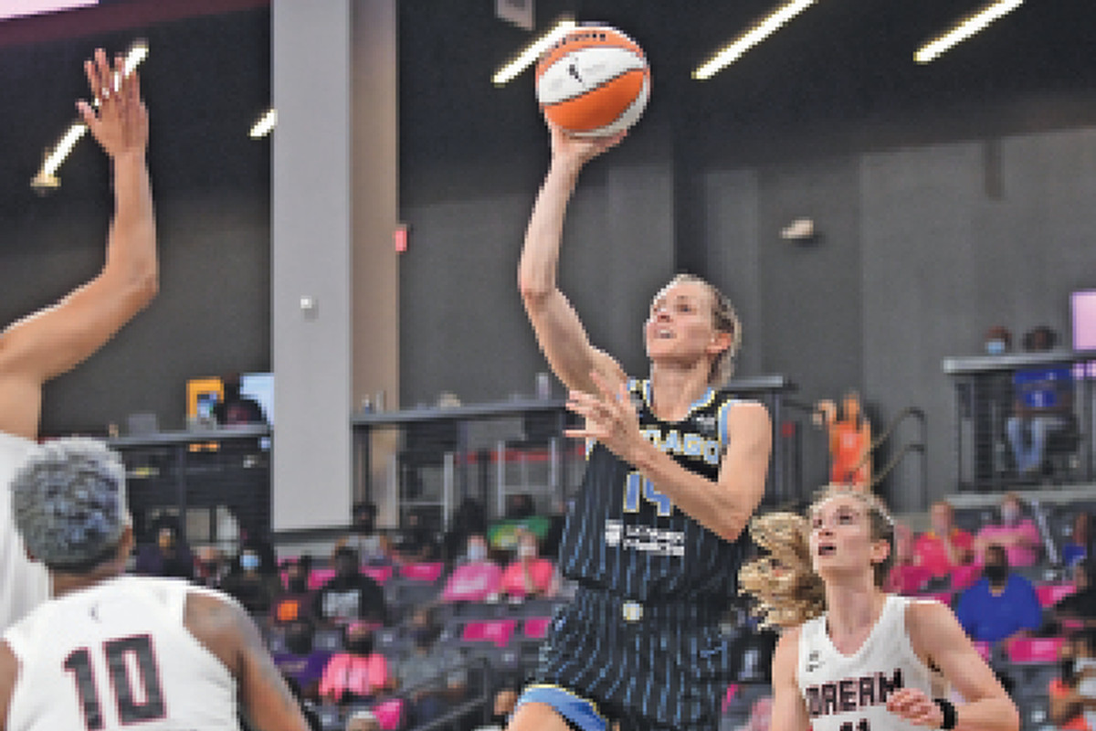 The Sky's Allie Quigley (21 points) puts up a shot against the Dream on Tuesday.