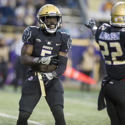 James Madison wide receiver Jamir Hudson (5) and running back Eric Kirlew (22) celebrate a first down in the fourth quarter against Stony Brook in an NCAA college football game in the FCS playoffs Saturday, Dec. 2, 2017, in Harrisonburg, Va. (Stephen Swofford/Daily News-Record via AP)