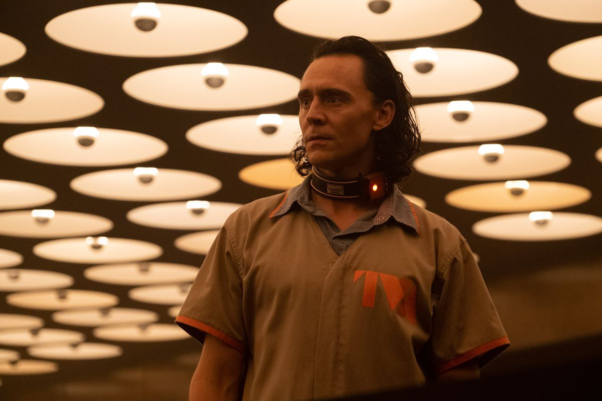 Loki standing in front of a bank of lights in Disney Plus' Loki