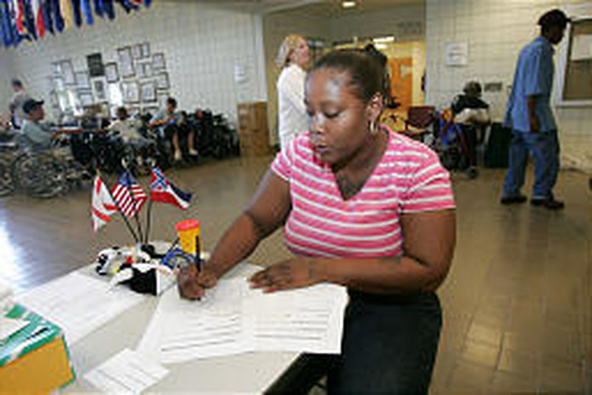 Rochelle Morris fills out a missing-persons form on Monday. She has a long list of family whose whereabouts are unknown.