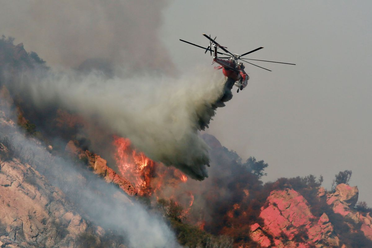Helicopter above Woolsey Fire