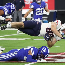 Brigham Young Cougars defensive back Hayden Livingston (28) upends Arizona Wildcats tight end Alex Lines (88) during the Vegas Kickoff Classic in Las Vegas on Saturday, Sept. 4, 2021. BYU won 24-16.