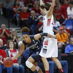 Brigham Young Cougars forward Morgan Bailey (41) is called for the offensive foul on Gonzaga Bulldogs forward Sunny Greinacher (14) during the West Coast championship Championship game in Las Vegas Tuesday, March 11, 2014. BYU lost 71-57.