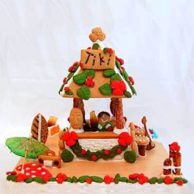 Gingerbread tiki hut with candy and icing.