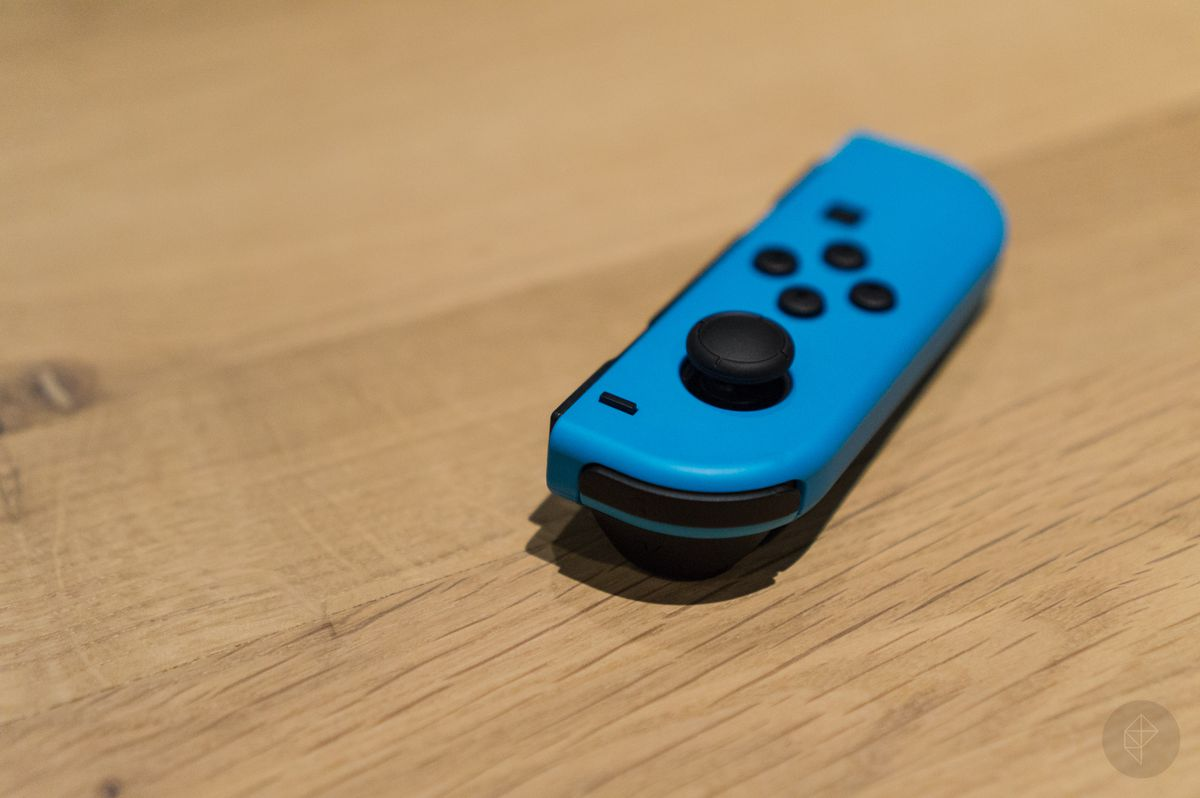 blue left Joy-Con for Nintendo Switch, on a wooden surface