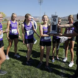 North Summit runners celebrate second place in the 2A girls high school state cross-country championship in Cedar City on Wednesday, Oct. 21, 2020.