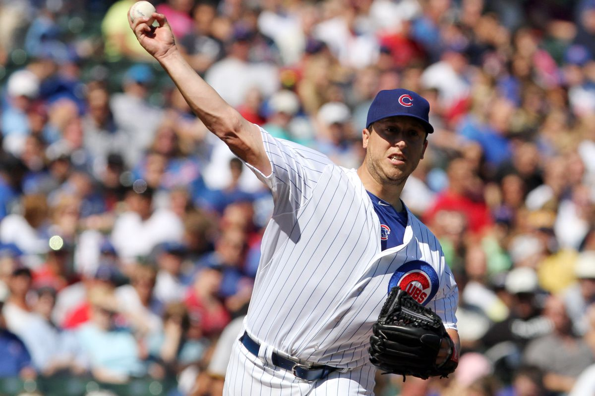 Jason Berken of the Chicago Cubs throws against the Pittsburgh Pirates at Wrigley Field in Chicago, Illinois.  (Photo by Tasos Katopodis/Getty Images)
