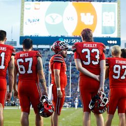 Utah players wait to warm up ahead of an NCAA college football game against BYU at LaVell Edwards Stadium in Provo on Saturday, Sept. 11, 2021.