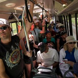 People ride a full shuttle through Zion National Park on Thursday, Sept. 15, 2016. More than a half-million people visited Zion National Park in June and so far this year, nearly two million tourists entered the park.