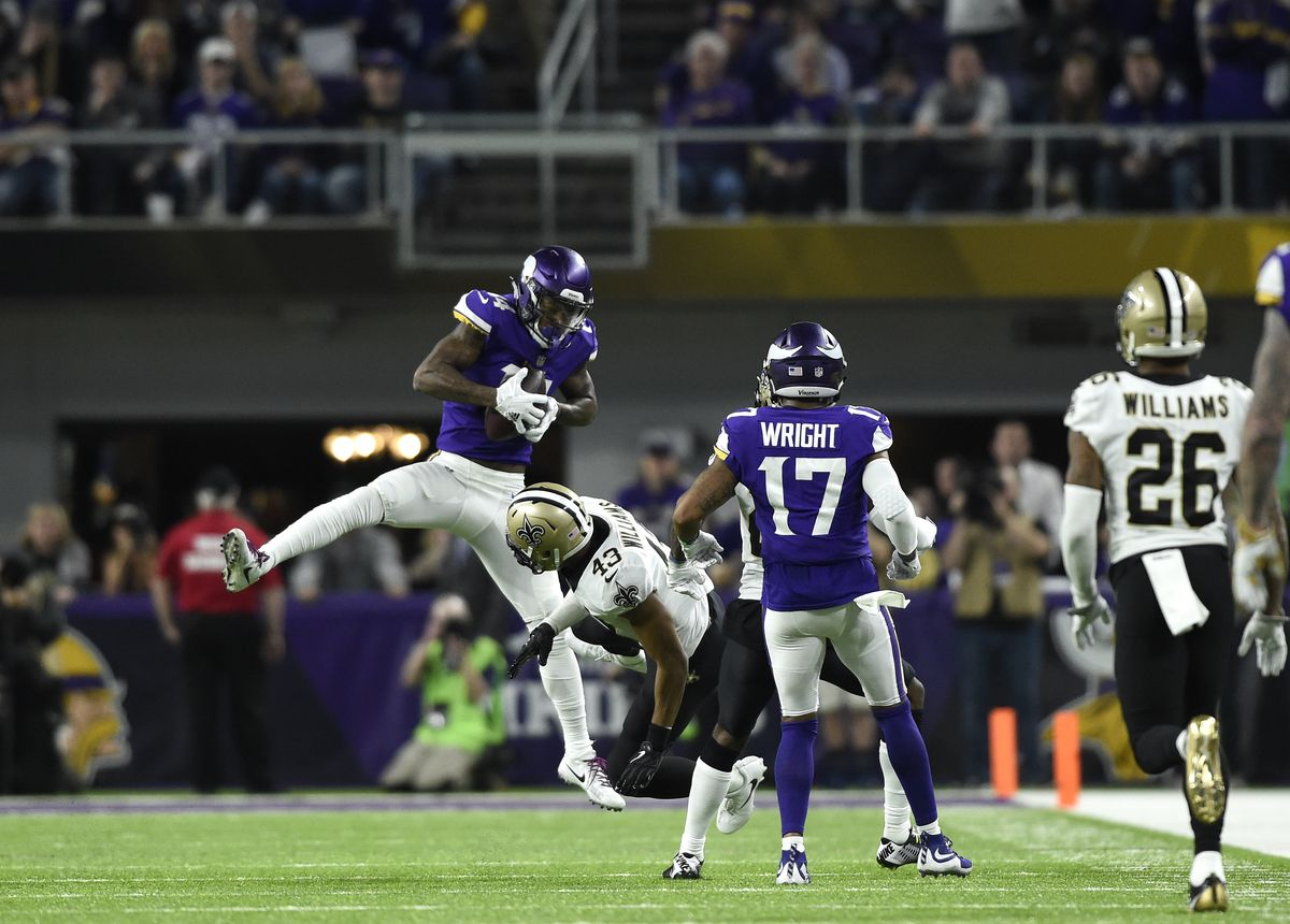 Stefon Diggs #14 of the Minnesota Vikings leaps to catch the ball in the fourth quarter of the NFC Divisional Playoff game.