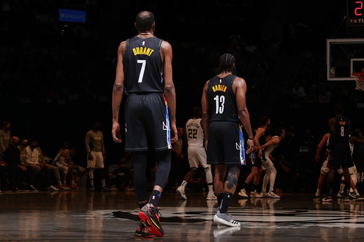 Kevin Durant of the Brooklyn Nets and James Harden of the Brooklyn Nets look on during Round 2, Game 5 of the 2021 NBA Playoffs on June 15, 2021 at Barclays Center in Brooklyn, New York.