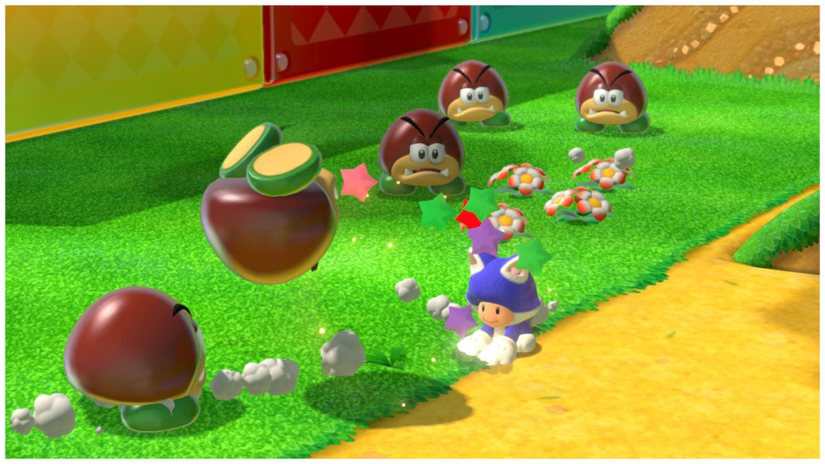 Toad, wearing a cat costume, punches a goomba into oblivion. Four other goombas watch the violence, their blank faces betraying their terror.