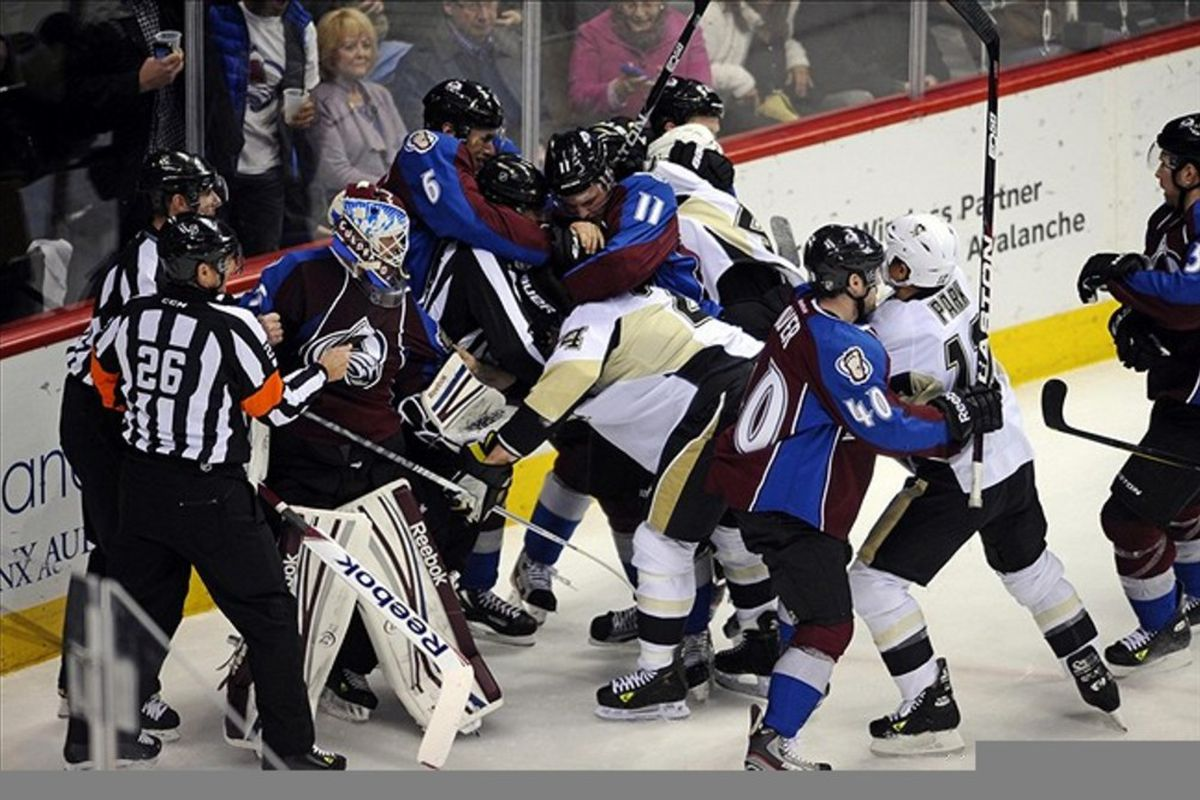 March 3 2012; Denver, CO, USA; Members of the Pittsburgh Penguins and the Colorado Avalanche fight during the second period of the game at the Pepsi Center. Mandatory Credit: Ron Chenoy-US PRESSWIRE
