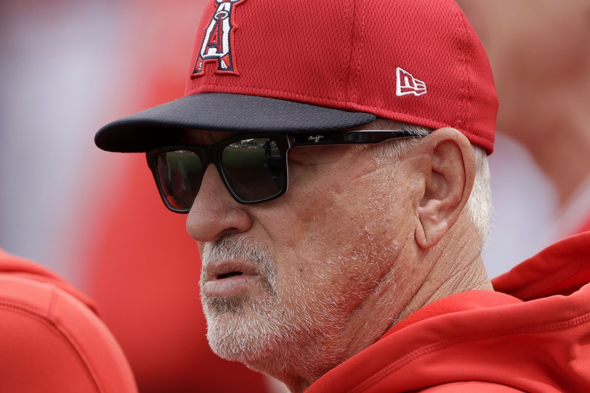 Angels manager Joe Maddon watches during the first inning of a spring training baseball game Friday, Feb. 28, 2020, in Tempe, Ariz.