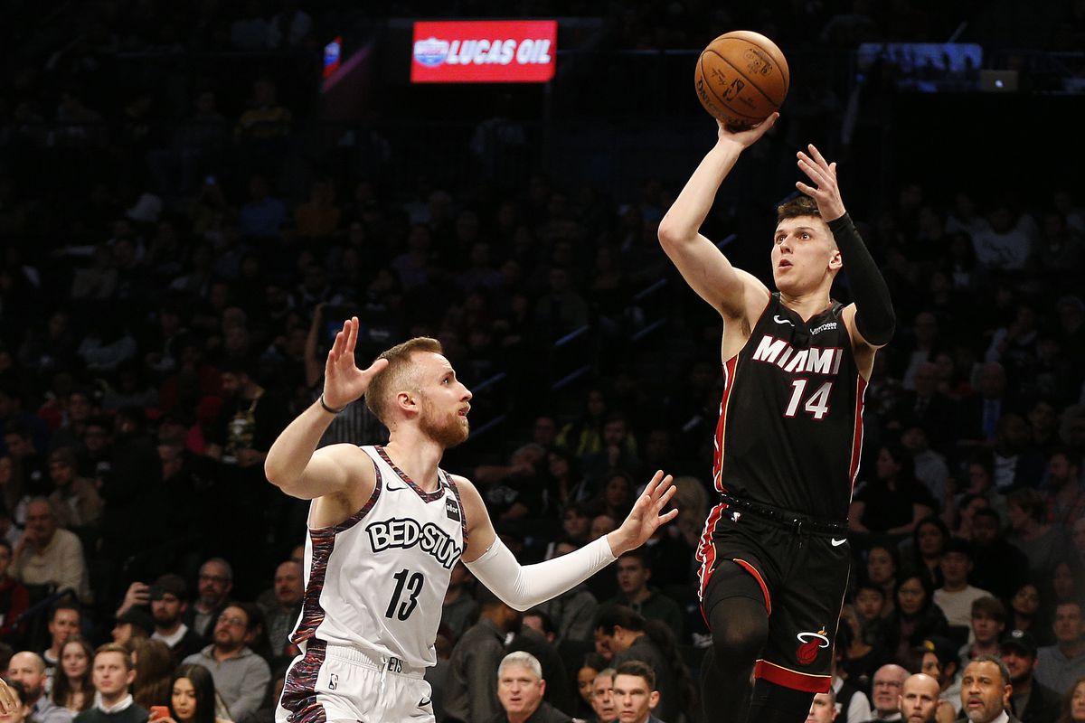 Miami Heat guard Tyler Herro shoots against Brooklyn Nets guard Dzanan Musa during the first half at Barclays Center.