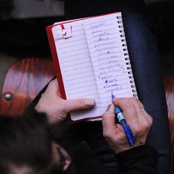 One of the parents writes down spelling of all contest words in her notebook during annual Citywide Spelling Bee Championship at the Lindblom Math and Science Academy on March 14, 2019. The winner will earn the opportunity to represent Chicago Public Schools at the Scripps National Spelling Bee in Washington, D.C., where they will compete against the best spellers from across the nation for the title of 2019 national Spelling Bee Champion and an opportunity to win a $40,000 prize. | Victor Hilitski/For the Sun-Times
