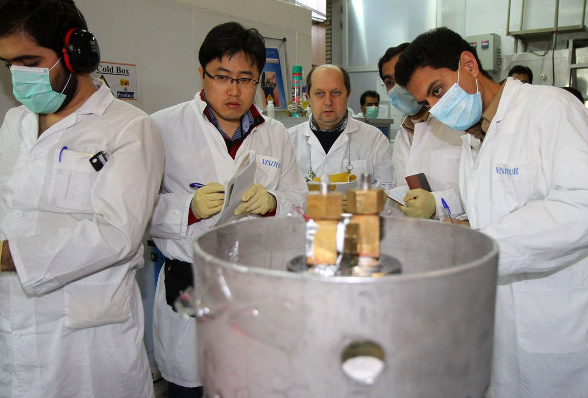 International Atomic Energy Agency inspectors supervise a centrifuge cascade at the Natanz enrichment facility in Iran.