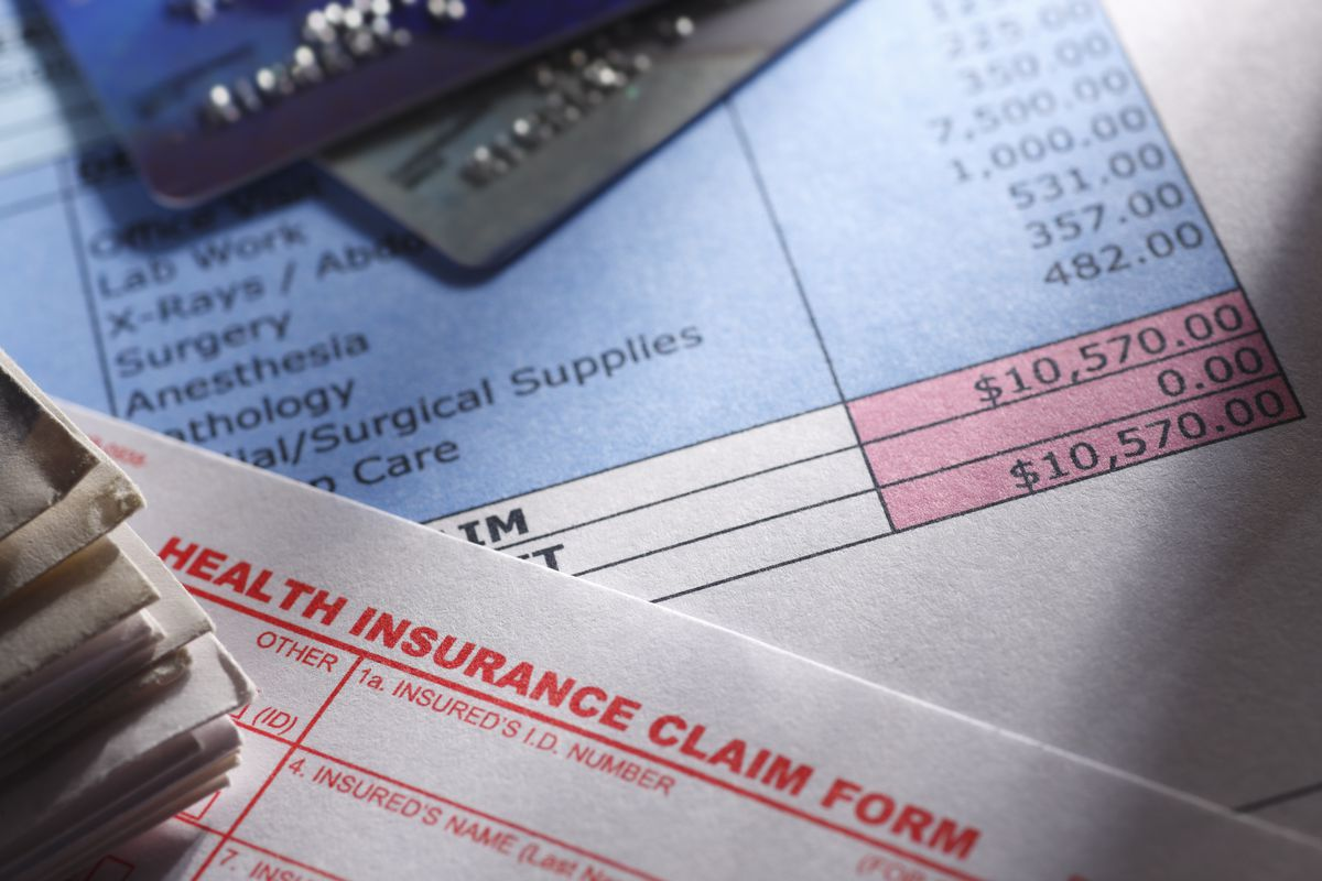 A close-up of a health insurance claim form showing a $10,000 amount due.
