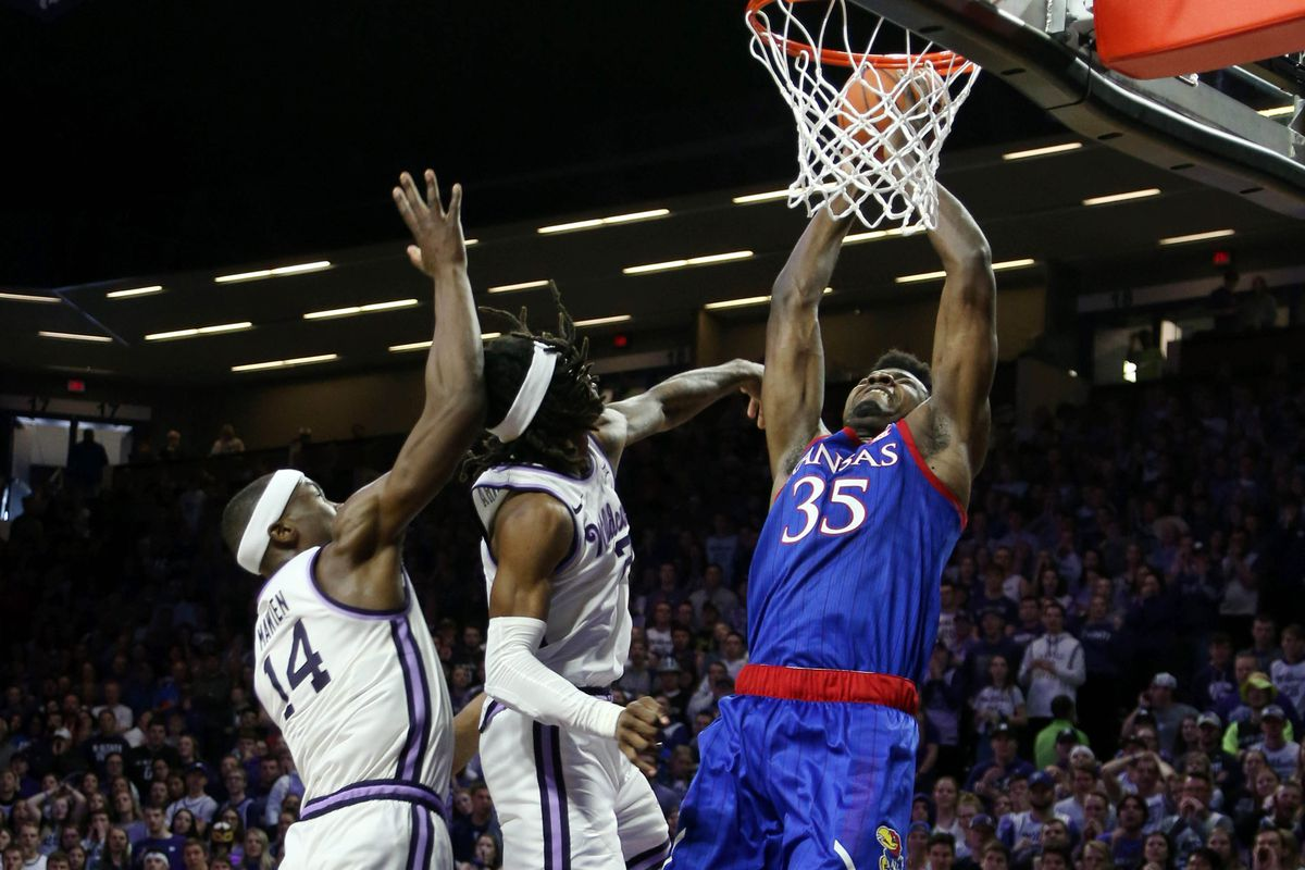 Kansas Jayhawks center Udoka Azubuike goes up for a shot against Kansas State Wildcats forward Makol Mawien and guard Cartier Diarra during the second half of a game at Bramlage Coliseum.