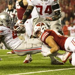 Wisconsin tackles Ohio State's Curtis Samuel.