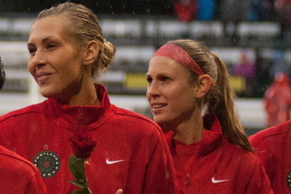 Port;and Thorns' midfielder Allie Long (L) and Nikki Marshall (R) receive their 2013 NWSL Championship rings prior to the match against FC Kansas City on April 26, 2014.