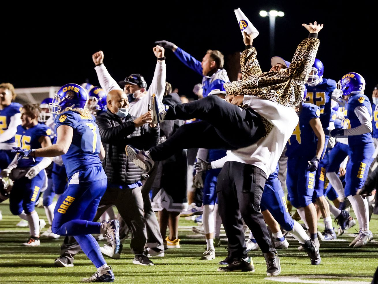 Orem head coach Gabe Sewell is lifted into the air as the team celebrates their win over Timpview in the 5A football state championship game at Cedar Valley High in Eagle Mountain on Friday, Nov. 20, 2020.