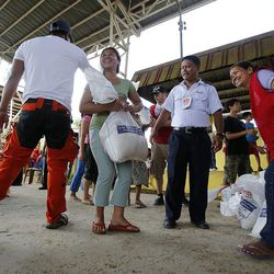 People receive relief goods from the Salvation Army in Tacloban, Friday, Nov. 22, 2013.