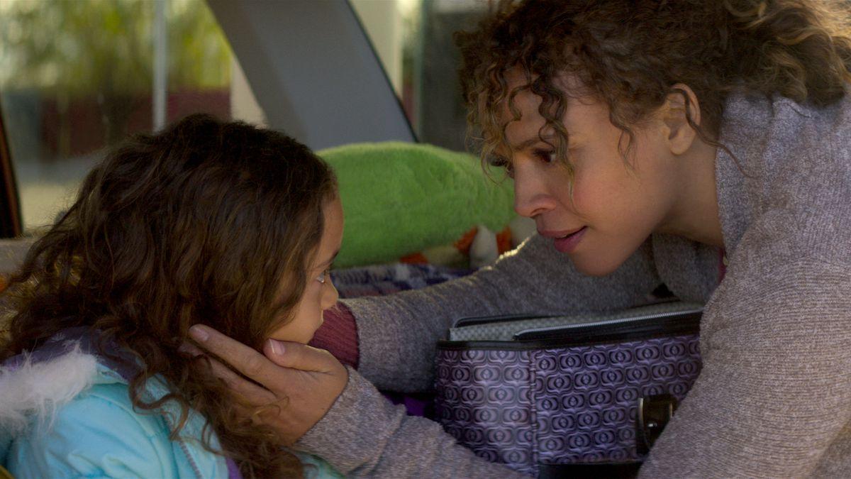 Katrina (Carmen Ejogo) comforts her young daughter.