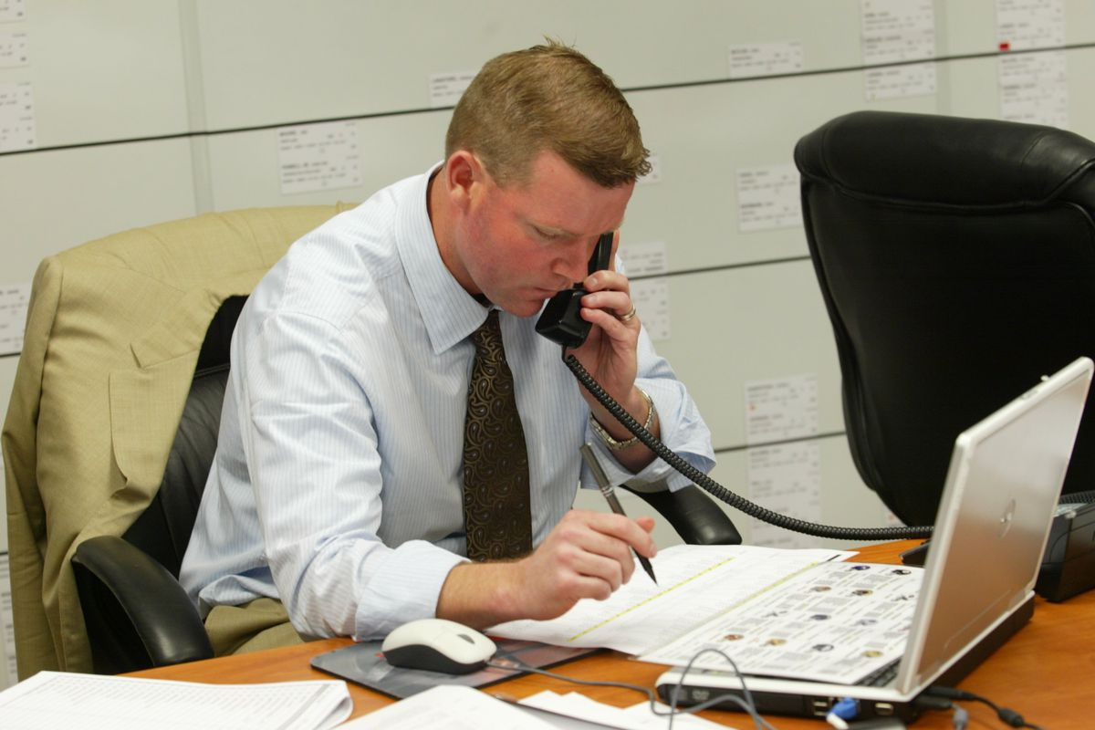VP of Player Personnel Scot McCloughan of the San Francisco 49ers talks on the phone during the 2008 NFL Draft in the draft room on April 26, 2008 in Santa Clara, California.