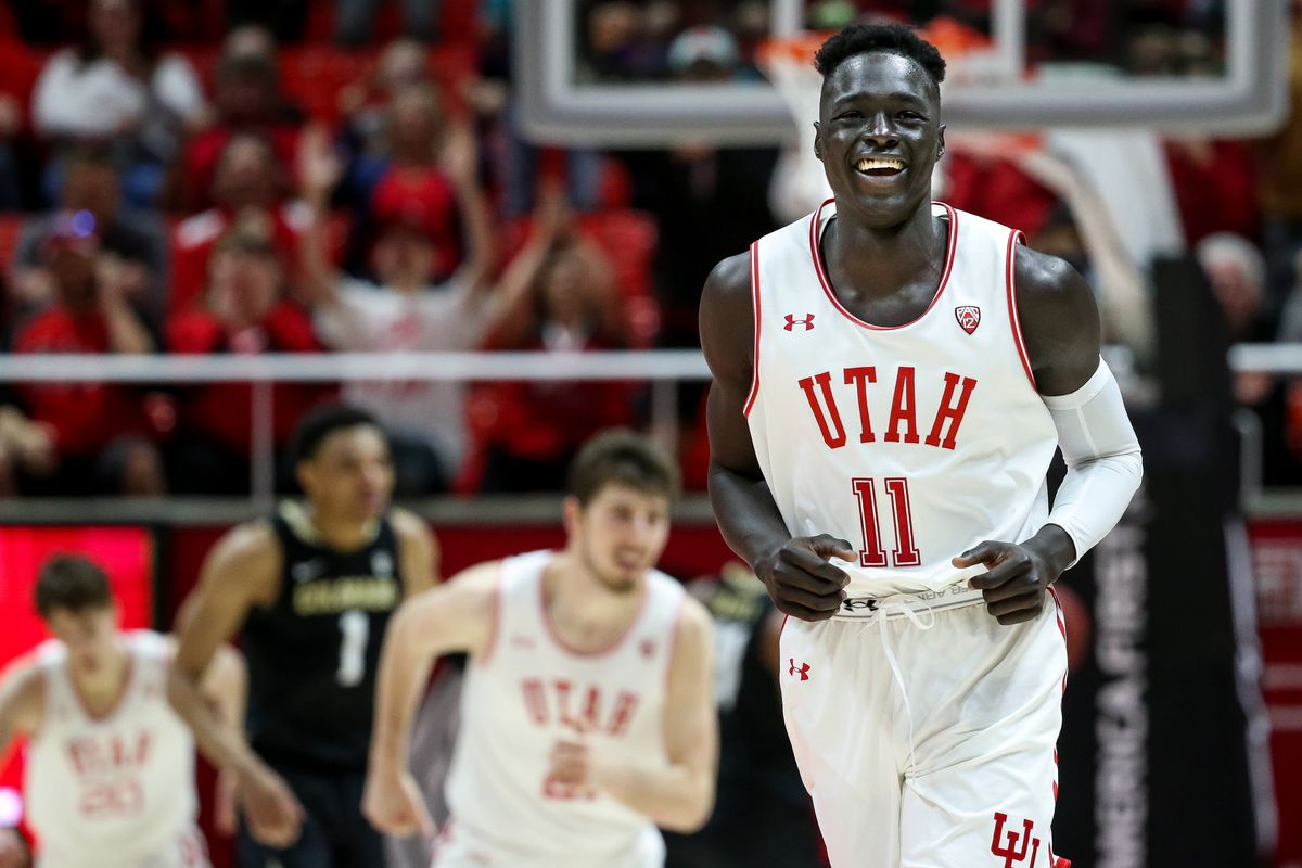 Utah Utes guard Both Gach (11) celebrates after hitting a 3-pointer. Gach is transferring back to Utah after a year at Minnesota.