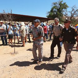 Law enforcement walk among the crowd prior to a meeting in Bluff with Interior Secretary Sally Jewell discussing the prpposed Bears Ears National Monument on Saturday, July 16, 2016.