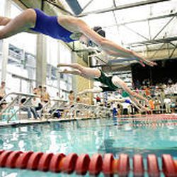 Swimmers from Skyline, Alta, Kearns and Murray compete at a quad meet hosted by Murray at the Park Center pool. Coach Larry Swim says the Spartans' depth may be their greatest strength.
