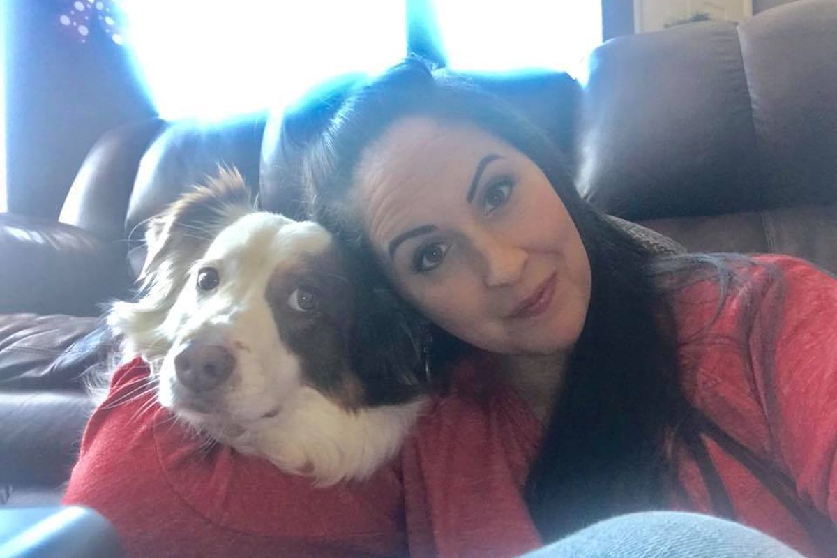 """Lindsy Bray and Dexter, a 5-year-old Australian Shepherd, pose for a selfie Thursday, Dec. 14, 2017, after Santaquin agreed to drop a charge of """"vicious dog"""" against Dexter, which required a mandatory sentence of euthanasia."""