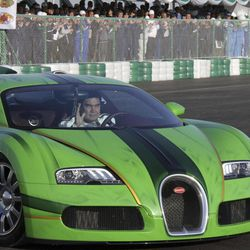Turkmenistan's President Gurbanguli Berdymukhamedov drives a Bugatti sports car while racing track in the capital, Ashgabat,Turkmenistan, Saturday, April 7, 2012. Turkmenistan's authoritarian leader has proven he doesn't only win elections easily, coming first in a car race he wasn't even supposed to take part in. Berdymukhamedov drove to the racing track in a Bugatti sports car Saturday morning ostensibly to give his blessing to the former Soviet Central Asian nation's maiden automotive competition. (AP Photo)